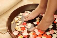 Feet dipped into spa & aromatherapy bowl