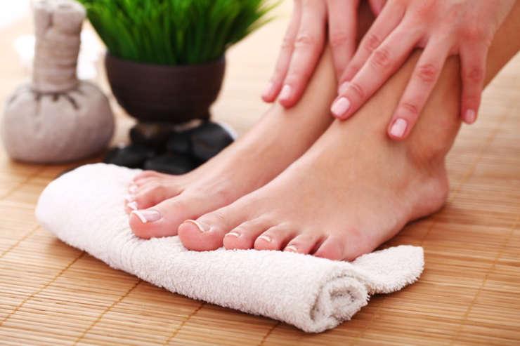 female feet after a ionic foot detox treatment